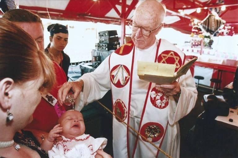 """alt='Father Mac The Carny Priest"""""""