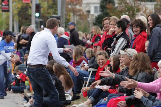 Secretary of State and U.S. Senate candidate Jason Kander (D) working the crowd at the University of Central Missouri Homecoming Parade in Warrensburg - October 24, 2015.