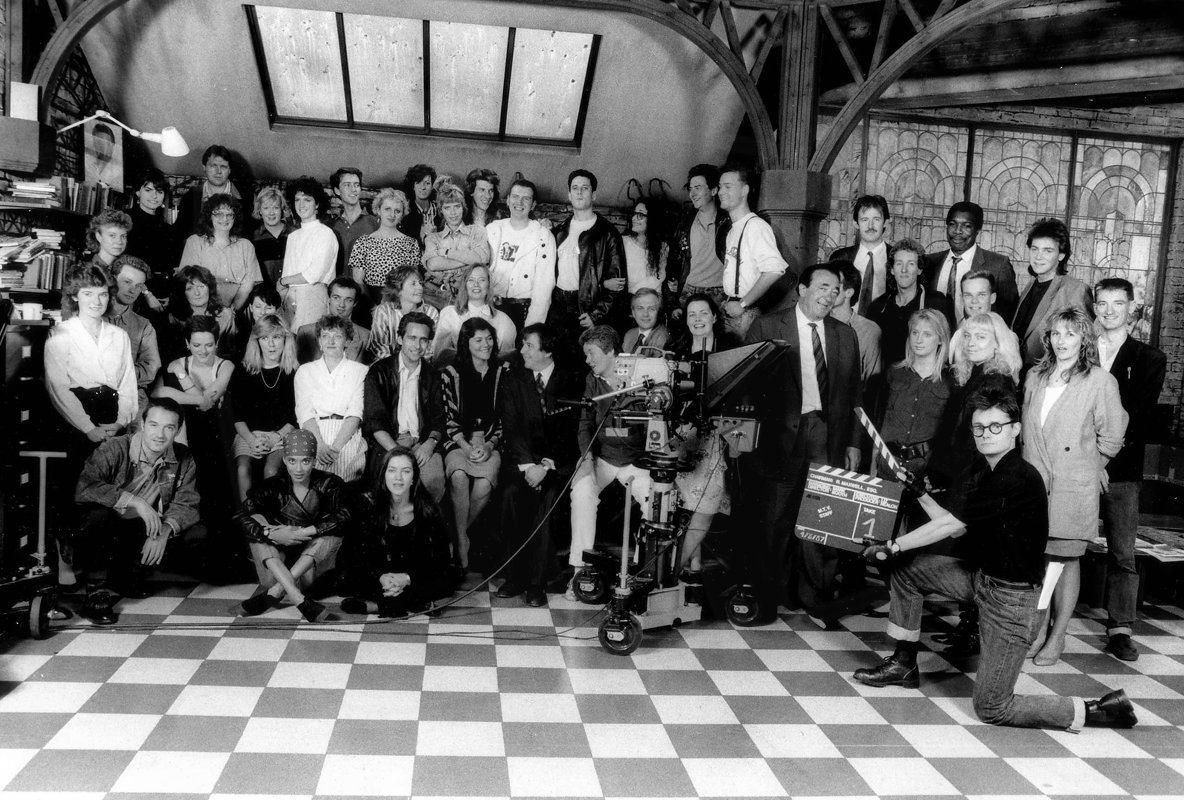 PICTURED: MTV Europe staff. Includes Jerry Foulkes (second from right, second row). Also includes Robert Maxwell (to the left of the clapperboard).
