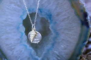Angel wing necklace Jewelry made from recycled sterling silver and gold brass, 16 inch sterling silver chain.