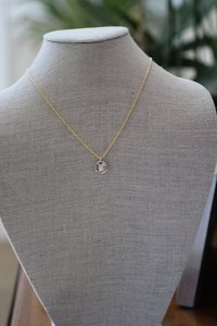 North Star necklace to guide you Jewelry made from recycled sterling silver with one ethically sourced champagne diamond on a 14k gold plated 21 inch chain. Pendant is approximately 1.5 inches.