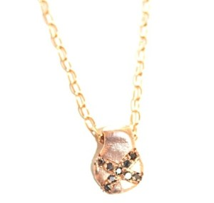 Jewelry made from recycled 14k gold with 9 black ethically sourced diamonds