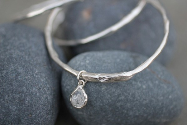 Circle of white light silver bangle
