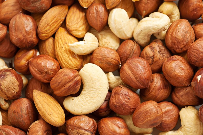 Background from various kinds of nuts almond, hazelnut, cashew, Brazil nut