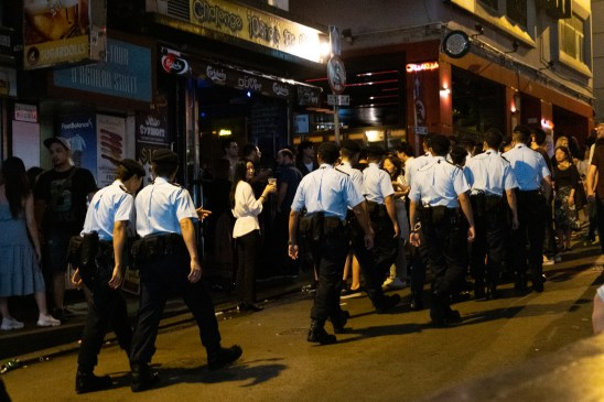 A large group of policeman in full suit were petroling at midnight in Lan Kwai Fong.