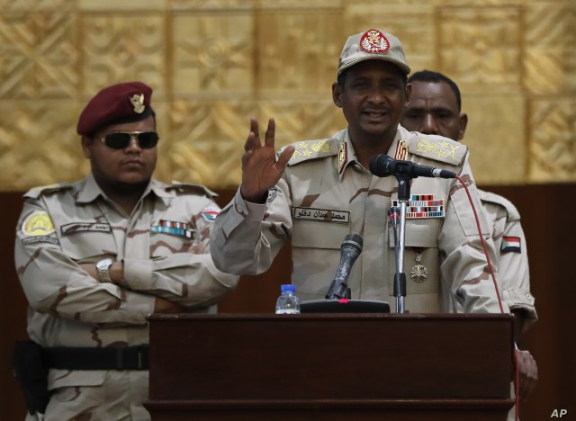 Sudanese Gen. Mohammed Hamdan Dagalo, the deputy head of the military council, speaks during a rally to support the new military council that assumed power in Sudan after the overthrow of President Omar al-Bashir, in Khartoum, Sudan, June 16, 2019.