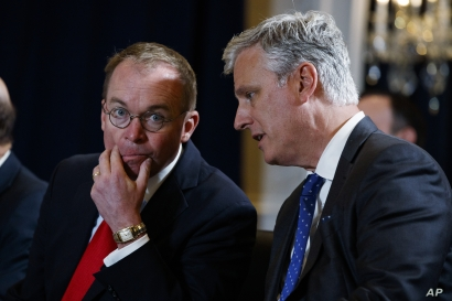 FILE - National Security Adviser Robert C. O'Brien (R) talks with White House chief of staff Mick Mulvaney during a meeting on the sidelines of the United Nations General Assembly, in New York, Sept. 23, 2019.
