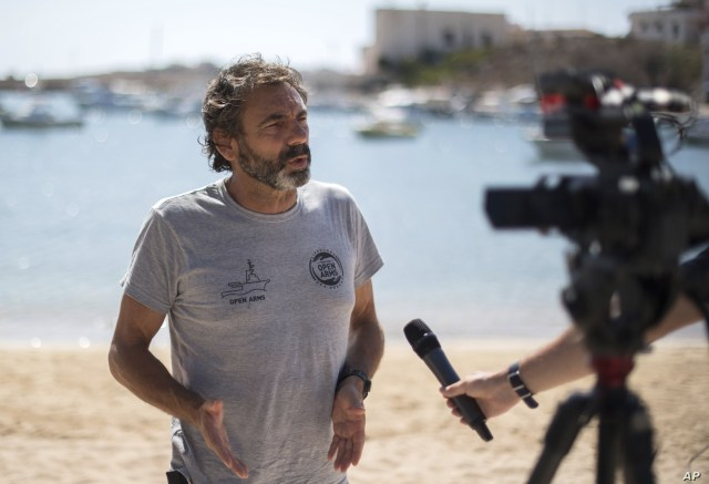 Open Arms founder Oscar Camps is photographed as he is interviewed by reporters on the Sicilian island of Lampedusa, southern Italy, Aug. 19, 2019.