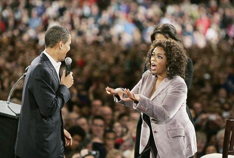 U.S. Democratic Presidential candidate Obama is joined by talk show host Oprah Winfrey and his wife Michelle at a rally in Des Moines