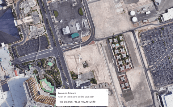 """The total distance from the billboard outside """"Mr. Deli"""" to where the videographer was standing is 748.05 m (2,454.25 ft), according to the """"measure distance"""" feature on Google Maps."""