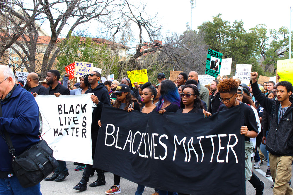 Protestors march to the Capitol.
