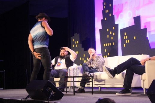Manu Bennett shakes his butt and grabs it in the middle of the Lord of the Rings/The Hobbit panel with Billy Boyd and John Noble. Photo by Catherine Gutierrez