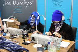 The Bumbly's booth attracted a huge crowd with its promise of giving anyone who dared an honest appraisal of their appearance. / Photo by Dana Summers