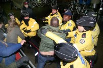 Police and activists clash at Toronto City Hall