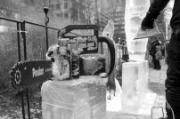 Brian Henry rests his ice sculpting chainsaw on a block of ice.
