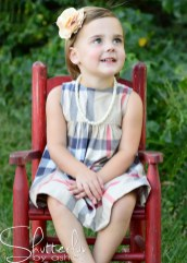 Love the red rocking chair with the red in the dress