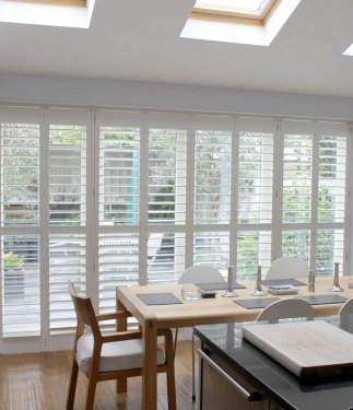Full Height 89mm LDF plantation shutters mounted on top track in a dining room
