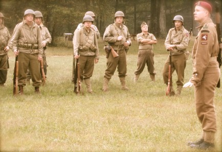 The 82nd Airborne Division squad stands in formation, with troopers of Fox Company, 325th Glider Infantry Regiment in the front row, and troopers of How Company, 504th Parachute Infantry Regiment in the back row.