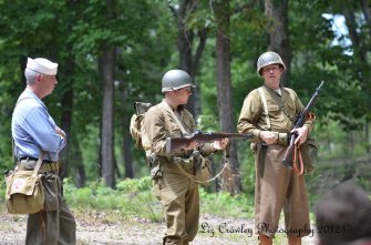 World War II-era 30th Infantry Division soldiers talking about their issued gear and weapons.