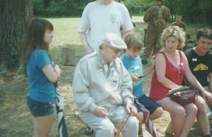 This gentleman was a German soldier during World War II. He was captured by the Russians and immigrated to the United States after the war. Here he is with his family, talking with the reenactors about his time in the German Army (Heer).