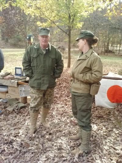 A Marine and a female (war correspondent or nurse?) soldier.