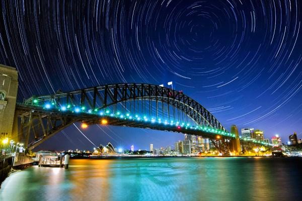 star trails above a bridge
