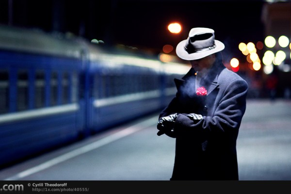 Man in suit waiting in railway station