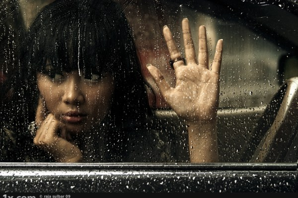 girl inside car looking outside