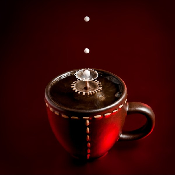 drops freezed over a coffee cup