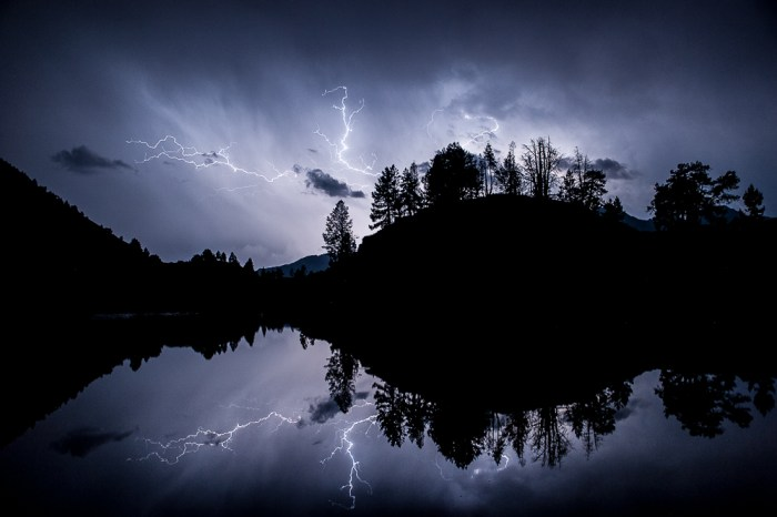 Storm reflected in a hidden lake, Pyrénées, France.
