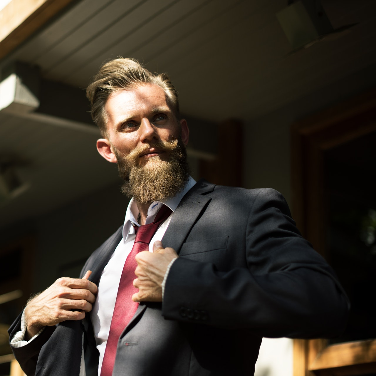 Photo of man in a suit with a mustache