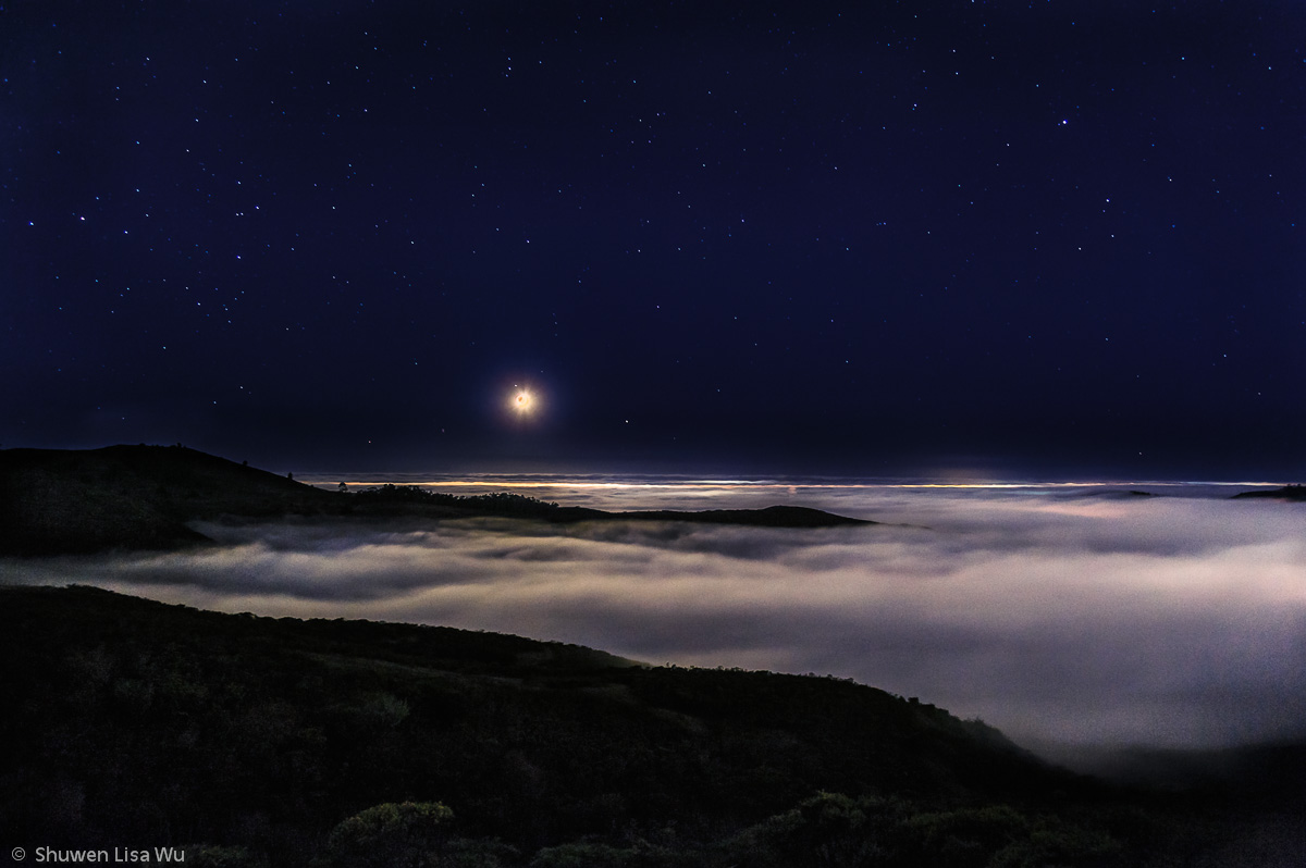 Photo of moon and marine layer over Half Moon Bay