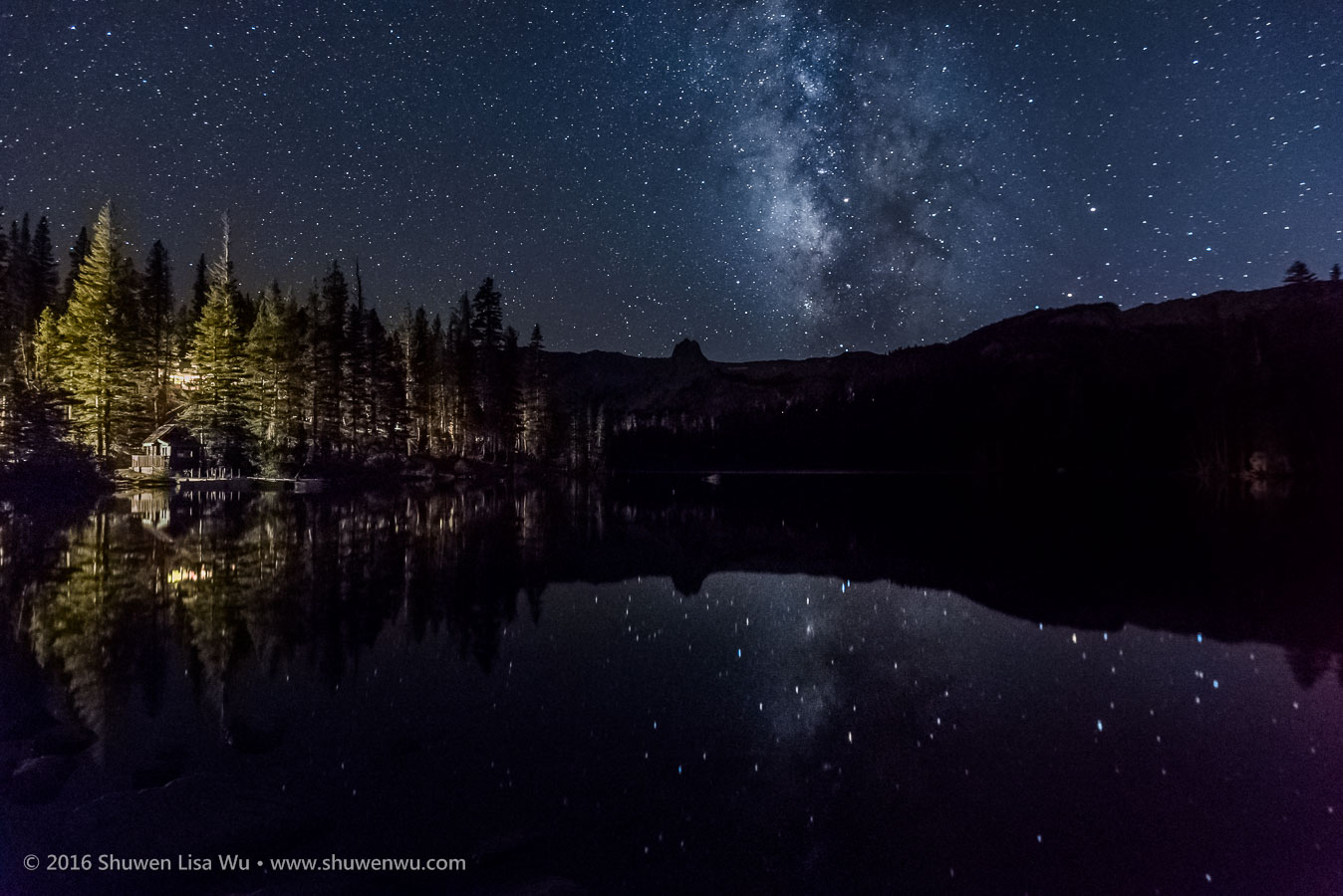 Stars and Milky Way reflect in Lake Mamie at night, Lake Mamie, Mammoth Lakes, California, September 2016.