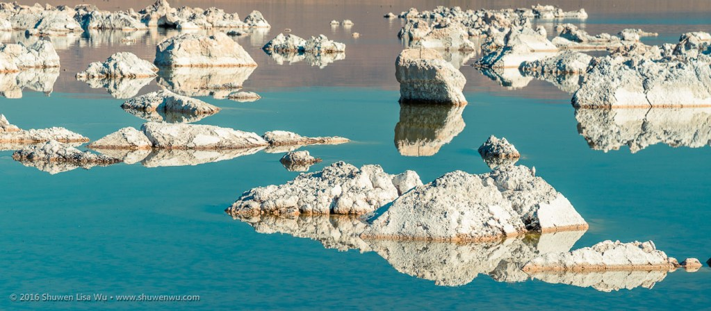 Tufa rocks reflecting in calm water at Mono Lake Tufa State Natural Reserve, Lee Vining, California, September 2016.