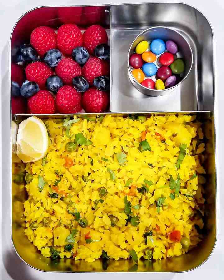 Poha, raspberries and blueberries and chocolate drops