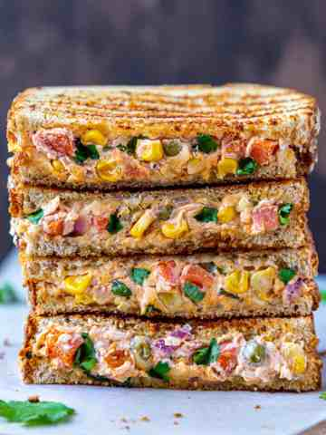 4 cut sandwiches stacked whoing the filling