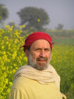 In a Braj field of mustard with the local style of winter cap