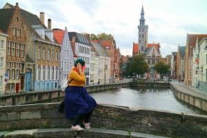 woman on a bridge in Brugge