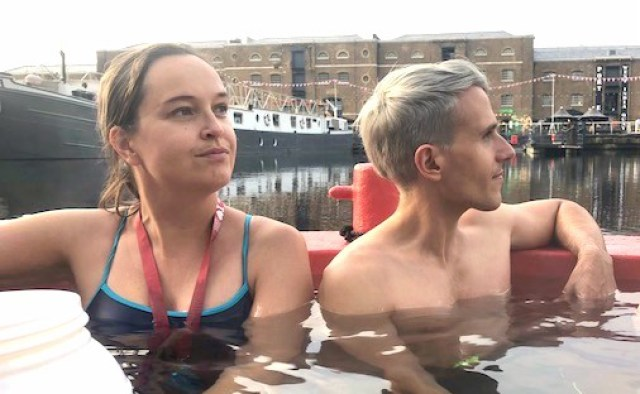 people in the floating hot tub