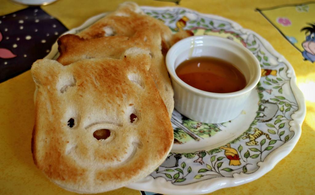 pooh shapped toast with maple syrupat pooh corner