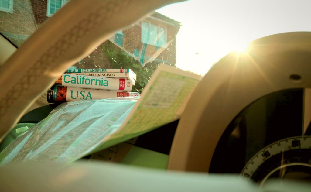 maps inside a car for planning a US road trip