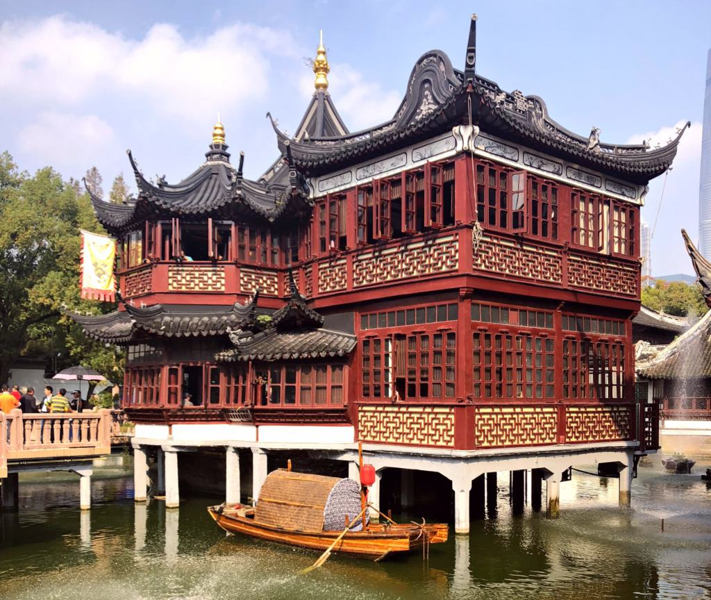 Chinese pagoda over a lake with a boat