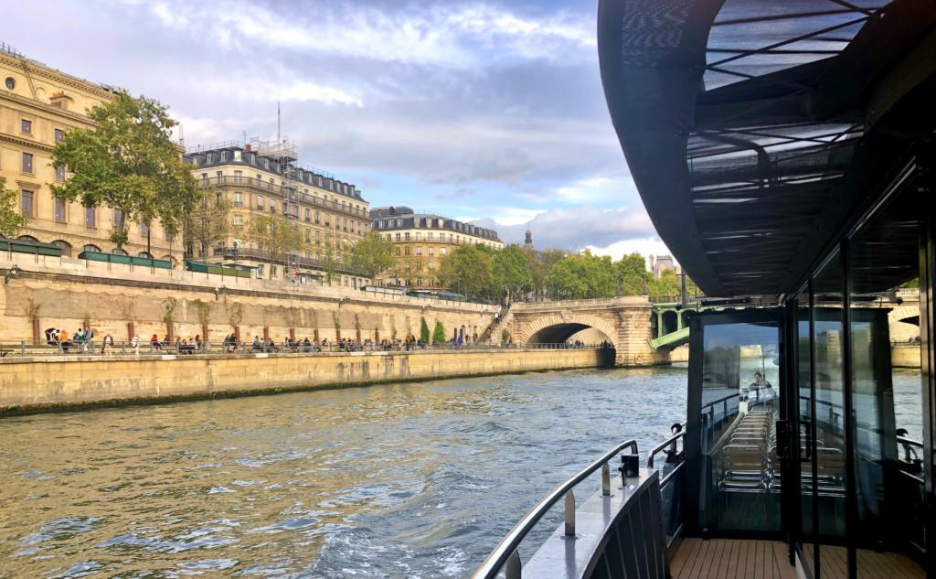View from the side of the boat on the Seine boat tour