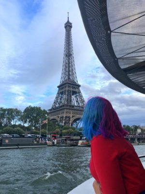 woman overlooking the Eiffel Tower from the Seine Boat Tour