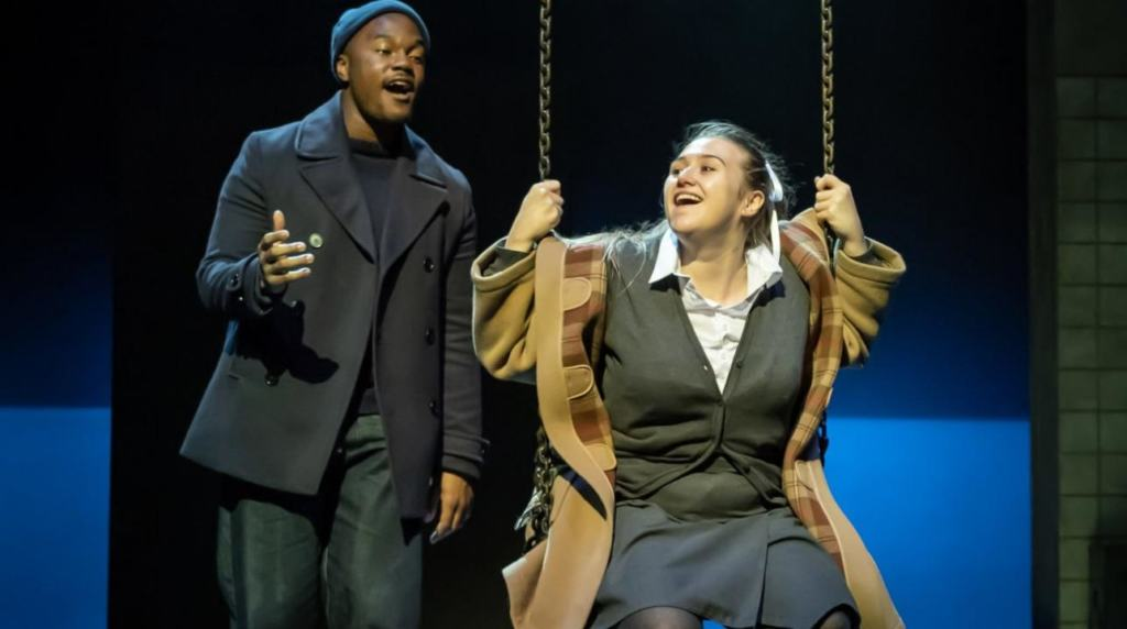cast of A Taste oh Honey on the swing on stage