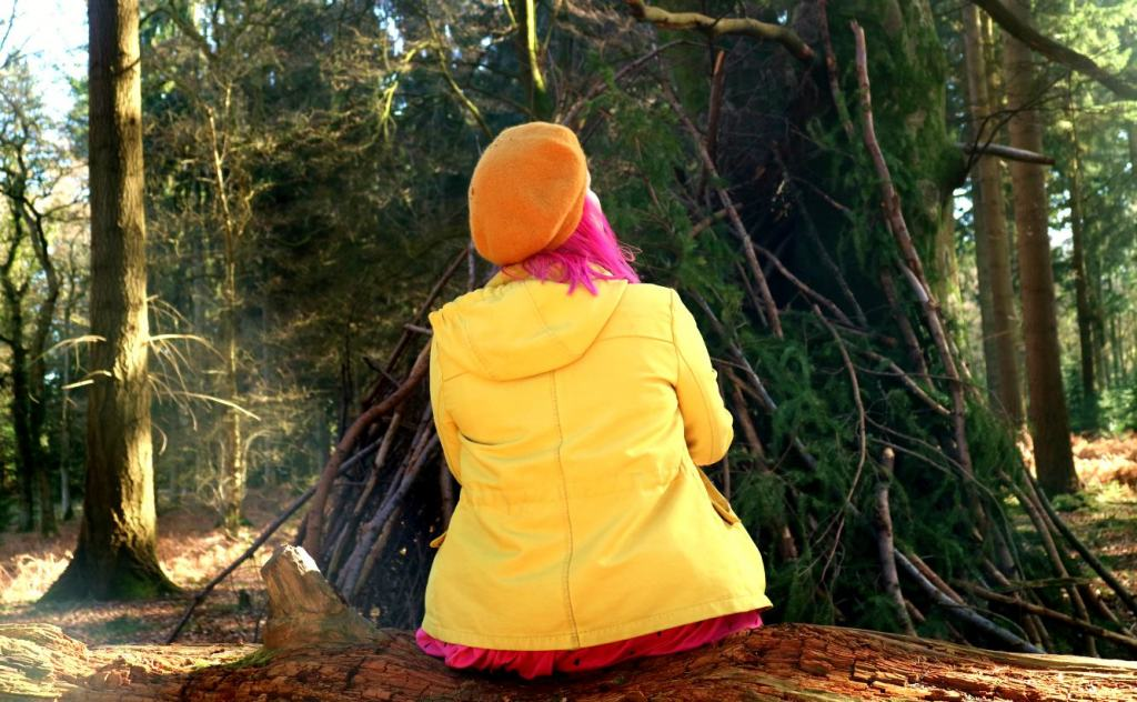 Kariss sitting in the woods in The New Forest