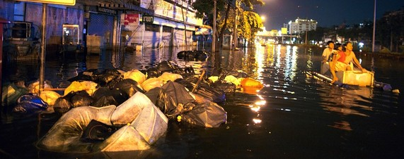 Garbage piled up on a flooded street in Bangkok, Thailand
