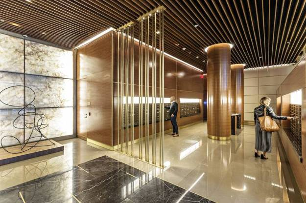 The mailroom at One Hudson Yards includes strips of backlit Brazilian quartzite and a high-gloss stone floor.
