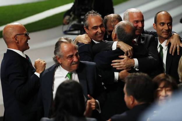 Members of the bid committee celebrate after Canada, Mexico and the U.S. won the vote to host the 2026 FIFA World Cup.