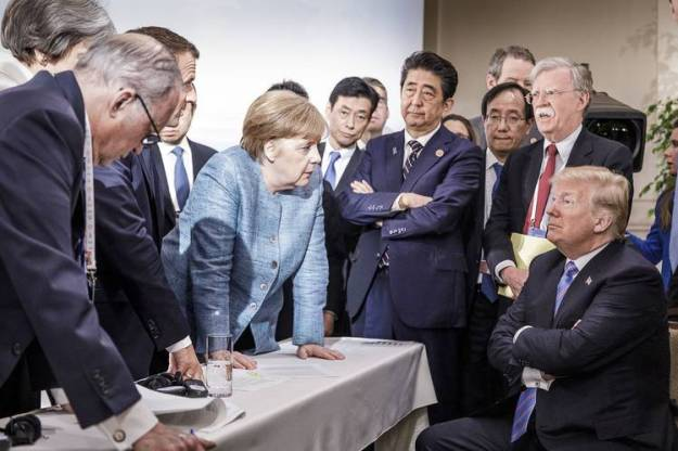 German Chancellor Angela Merkel and other leaders talking with U.S. President Donald Trump at last week's Group of Seven meeting, which ended in discord over trade.